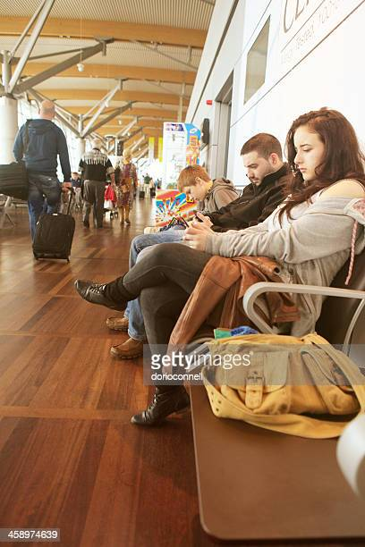 people waiting at the airport - cork city stock pictures, royalty-free photos & images