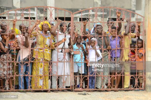 People waiting at the gate of Nigeria Red Cross Society of Nigeria as they distributes of Emergency kits of food and essential supplies to residences...