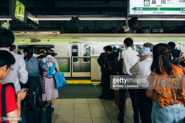 People waiting for a train in Japan