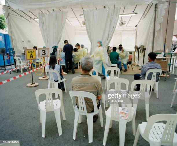 People Waiting for Assistance at Temporary SARS Clinic