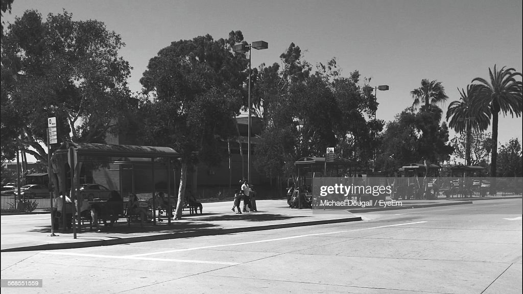 People Waiting For Bus On Bus Stop : Stock Photo