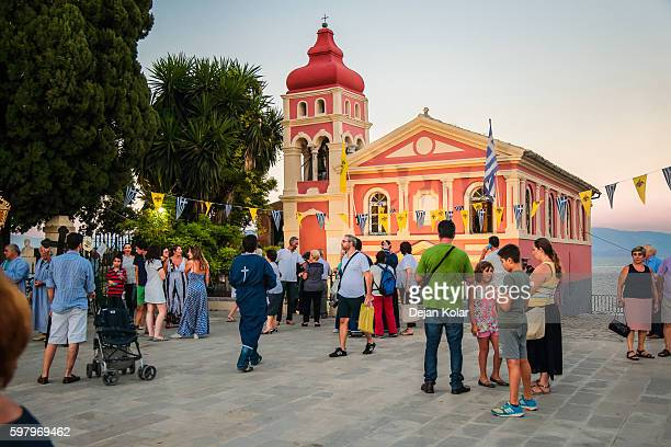 People waiting for ceremony at Mandrakinas Church, Corfu, Greece