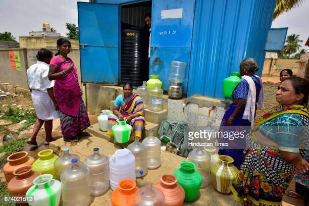People waiting for filtered water at Vemagallu of Kolar on April 21 2017 near Bengaluru India Karnataka has been reeling under severe drought for the...