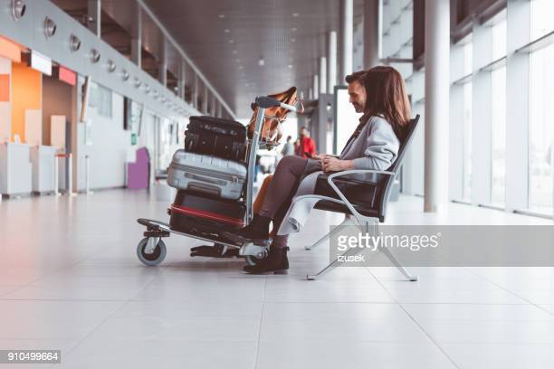 People waiting for flight in airport lounge