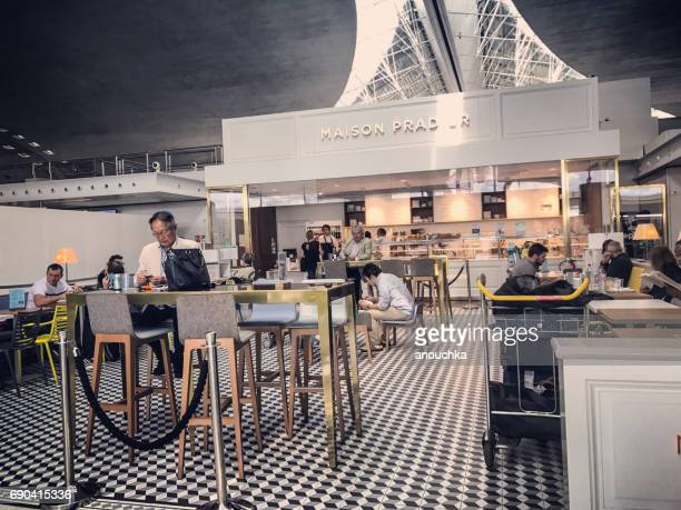 People waiting for flight in Maison Pradier cafe at People traveling through Roissy Charles de Gaulle Airport, Paris