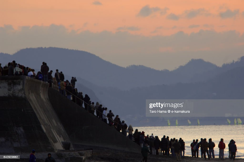 People waiting for new year's rising sun on the beach : ストックフォト