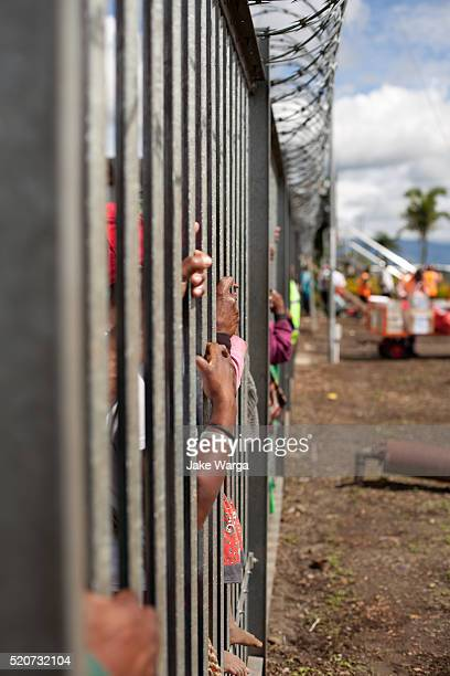 people waiting for plane at local airport, papua new guinea - jake warga stock pictures, royalty-free photos & images