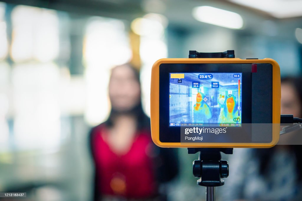 People waiting for temperature check by thermoscan : Stock Photo