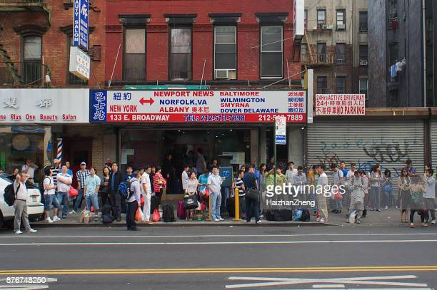 people waiting for the bus in chinatown - flushing queens stock pictures, royalty-free photos & images