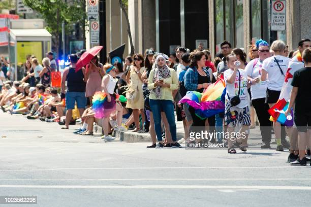 People waiting for the LGBTQ Pride Parade in Montreal street.