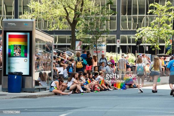 "people waiting for the lgbtq pride parade in montreal street. - ""martine doucet"" or martinedoucet stock pictures, royalty-free photos & images"