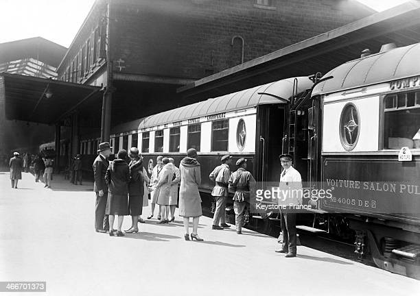 People waiting for the passengers of a luxury train to get off the train at the Gare de Lyon in May 1929 in Paris France