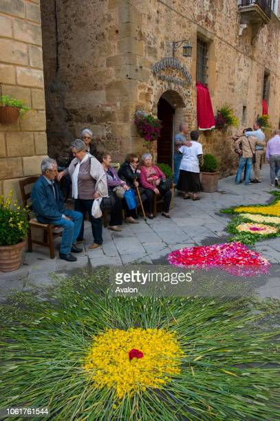 People waiting for the procession in street decorated with flowers for the Corpus Christi holiday, a catholic observance that honors the Holy...