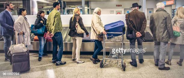 People waiting for their luggage at an airport