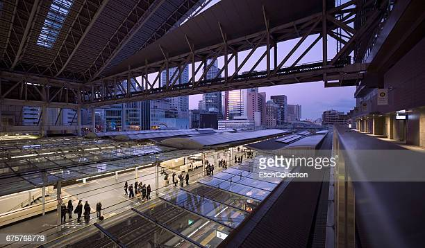 People waiting for train at Osaka Station at dawn