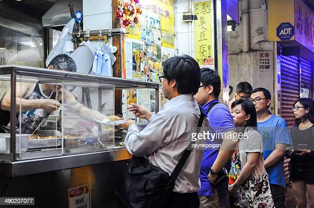 People waiting in a line for street food,Hong Kong