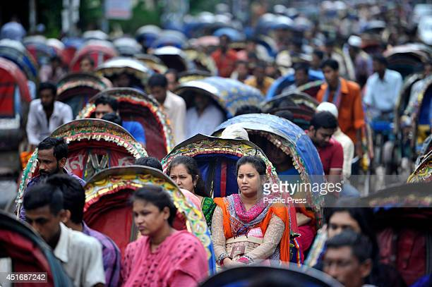 People waiting in a rickshaw Jam in Dhaka This is the start of the Ramadan rush in shopping malls and markets Muslims throughout the world are...