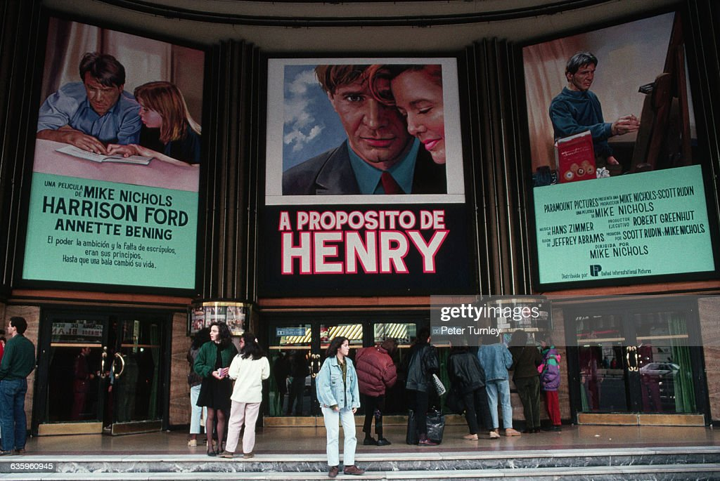 People Waiting in Front of a Movie Theater : News Photo