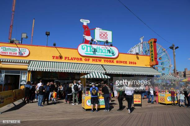 People waiting in front of Nathan's Famous Hot Dogs & Restaurant along the boardwalk at Coney Island, Brooklyn, New York City
