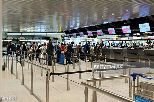 People waiting in line for check-in, Schipol Airpot