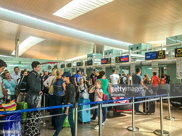 People waiting in line for flight check-in, Barcelona Airport