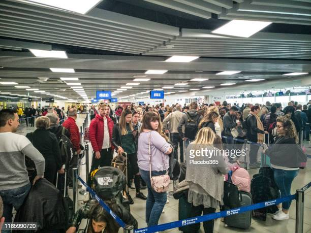 people waiting in line for security check at airport european international departures - transportation security administration stock pictures, royalty-free photos & images