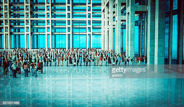 People waiting in line, office building