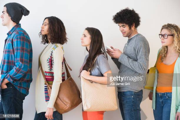 people waiting in line - lining up stock pictures, royalty-free photos & images