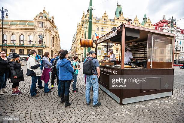 People waiting in line to buy famous Trdelnik, Prague