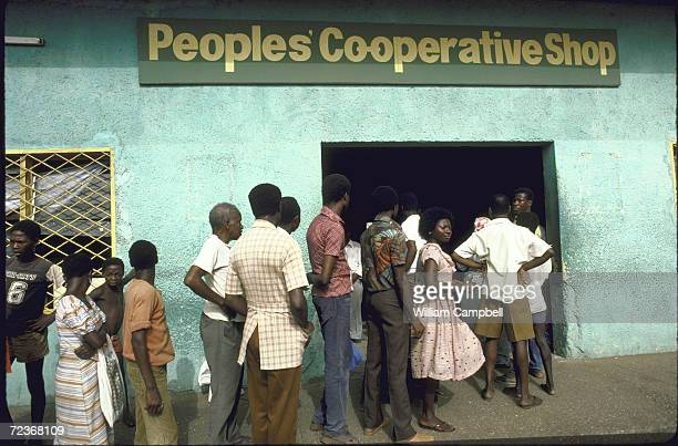 People waiting in line to buy sugar at official prices outside Peoples' Cooperative Store