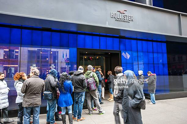 People waiting in line to enter Hollister store, NYC