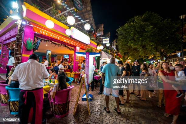 people waiting in line to enter restaurant on 5th avenue, playa del carmen, mexico - mayan riviera stock photos and pictures