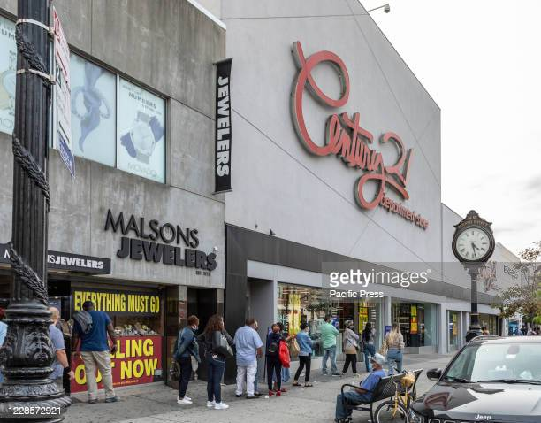 People waiting in line to get into Century 21 Department Store. All stores will be closed and the company will going out of business amid COVID-19...