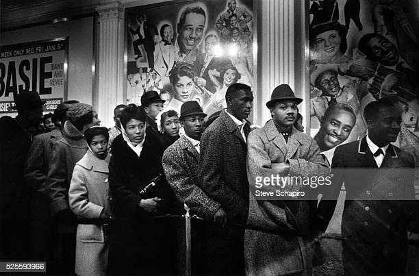 People waiting in line to get outside the Apollo Theater, New York, New York, 1960.
