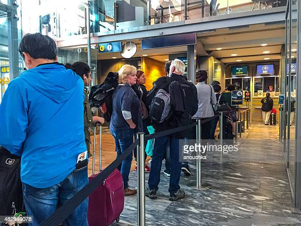 People waiting in line to go through Passport Control, Oslo