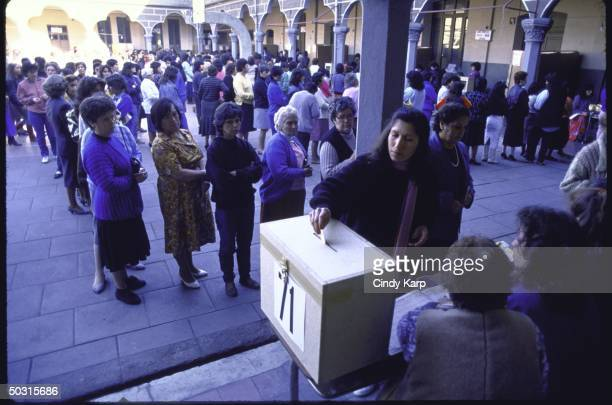 People waiting in line to vote during plebiscite election on future of dictator Augusto Pinochet