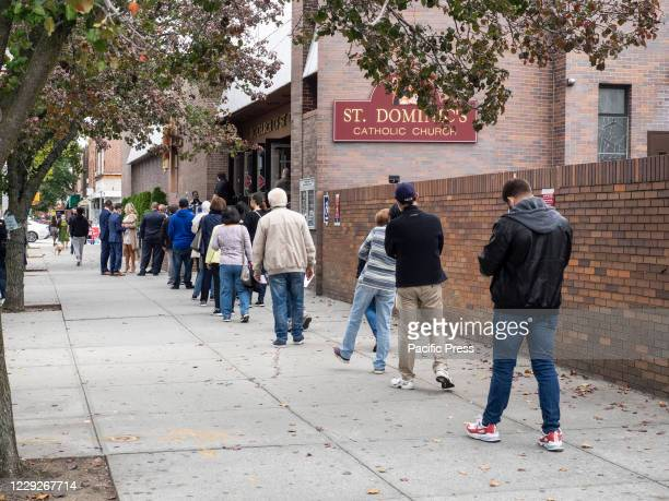 People waiting in line to vote for early Presidential voting at St. Dominic's Catolic Church, Brooklyn amid coronavirus pandemic.