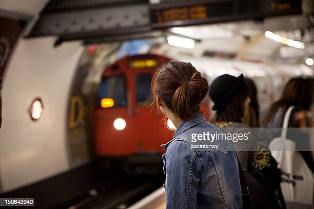 people waiting on platform - tube stock pictures, royalty-free photos & images