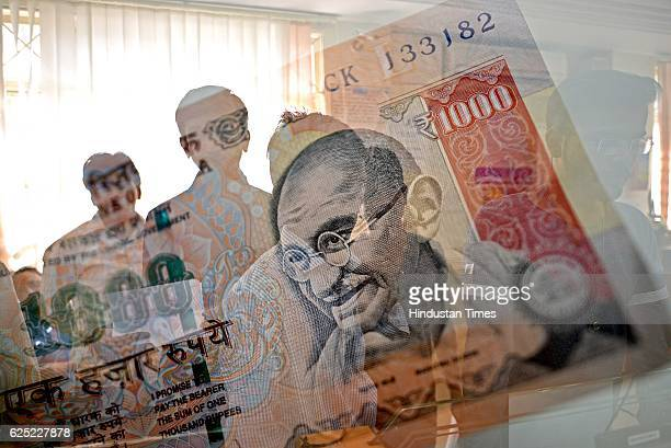People waiting outside in a queue to exchange their old currency notes with the new one and deposit cheque at State Bank of Hyderabad Dadar on...
