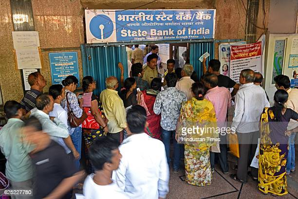 People waiting outside in queue to exchange their old currency notes with the new one and deposit cheque at SBI Bank Thane on November 21 2016 in...