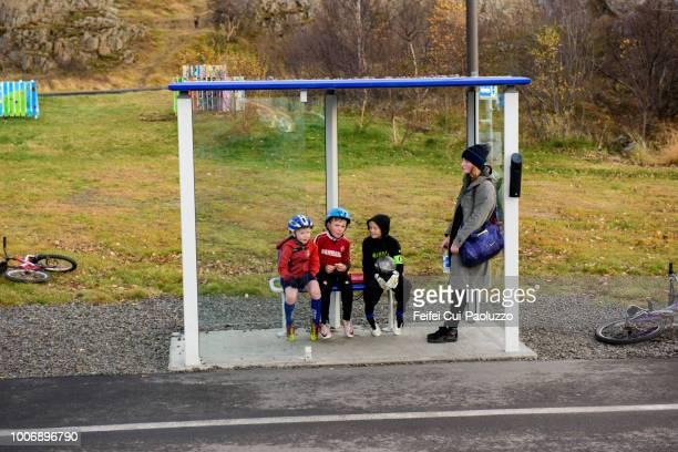 people waiting the bus at bus station in egilsstaðir, iceland - austurland stock-fotos und bilder