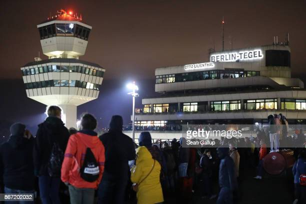 People waiting to catch a glimpse of the last Air Berlin flight to arrive wait on the visitors' terrace at Tegel Airport on October 27 2017 in Berlin...