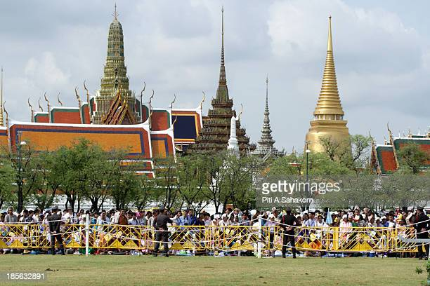 People waiting to collect rice seeds from the annual Royal Ploughing Ceremony at Sanam Luang Thailand's Crown Prince Maha Vajiralongkorn and Princess...