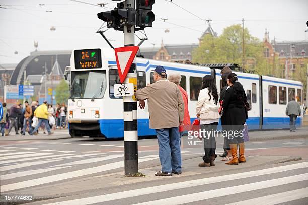 People waiting to cross the street at Damrak, Amsterdam