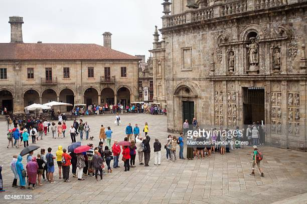 people waiting to enter cathedral of santiago de compostela - camino de santiago stock pictures, royalty-free photos & images