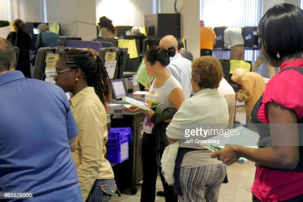 People waiting to use the voting machines in City Hall at Miami Beach