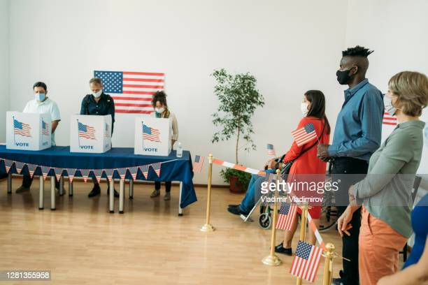 people waiting to vote on election day - presidential candidate stock pictures, royalty-free photos & images