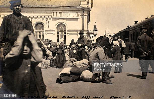 People waiting with their baggage on the platform of the Chelyabinsk railway station Russia on 2nd June 1908