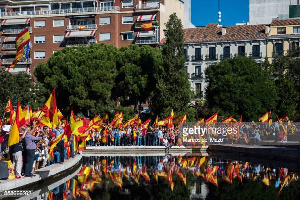 People waiving Spanish flags during a demonstration demanding the unity of Spain and against the independence of Catalonia