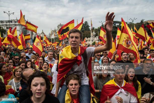People waiving Spanish flags protesting in front of the City Hall demanding the unity of Spain and against the possible referendum that will take in...